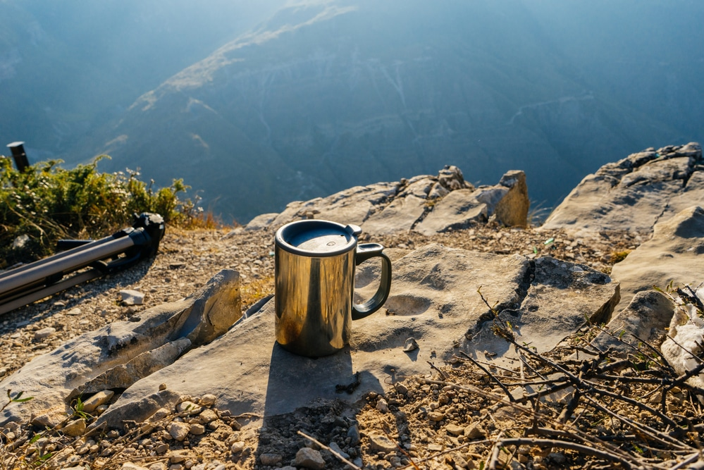 Cup with coffee in the background of high mountains
