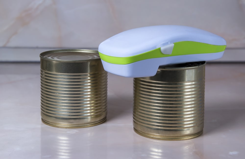 Using an electric tool to open canned goods